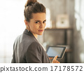 Portrait of business woman using tablet pc in loft apartment 17178572