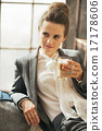 Portrait of thoughtful business woman drinking coffee latte in l 17178606