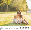 Mother and baby relaxing in park 17178721