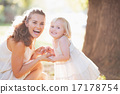 Portrait of happy mother and baby in park 17178754