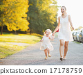 Happy mother and baby walking in city 17178759