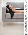 Girl sleeping on sofa in living room 17179557