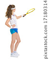 Full length portrait of happy tennis player pointing with racket 17180314