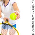 Closeup on female tennis player serving ball 17180374