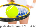 Closeup on female tennis player holding racket with ball 17180437