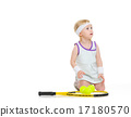 Baby in tennis clothes with racket and balls looking on copy spa 17180570