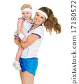 Portrait of happy mother and baby in tennis clothes 17180572