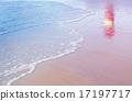 lighthouse reflection among sea waves on beach 17197717