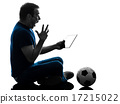 man holding watching digital tablet  silhouette 17215022