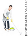young man uses vacuum cleaner 17216887
