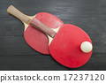 Two red table tennis rackets on dark background 17237120