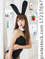 A young lady in a bunny girl posing with a white room as a background 17237647