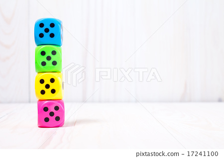 Dice stacked on the wooden surface 17241100