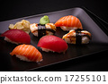 Eel, salmon and tuna sushi with chopsticks 17255101