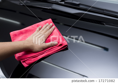 Stock Photo: Car polishing series : worker cleaning black car