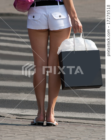 slender legs of a young girl in white shorts - Stock Photo ...