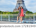 Twin sisters in front of the Eiffel tower in Paris, France 17281949