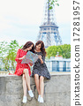 Beautiful twin sisters using map in Paris 17281957