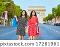 Beautiful twin sisters shopping in Paris 17281961
