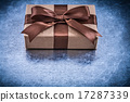 Packed gift boxes with brown ribbon horizontal version holidays  17287339