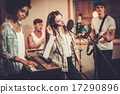 Multiracial music band performing in a recording studio 17290896