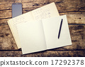 Exercise book with smartphone and pen on old wooden table 17292378