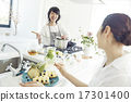 A woman in a bright kitchen 17301400