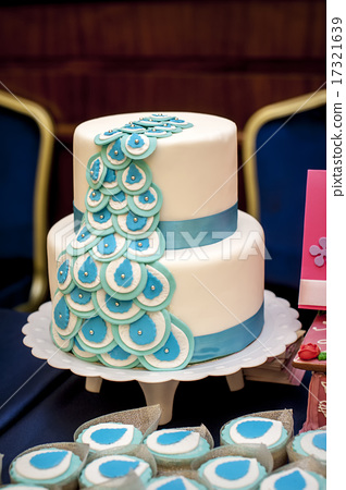 Two-tiered wedding cake with blue ribbons 17321639