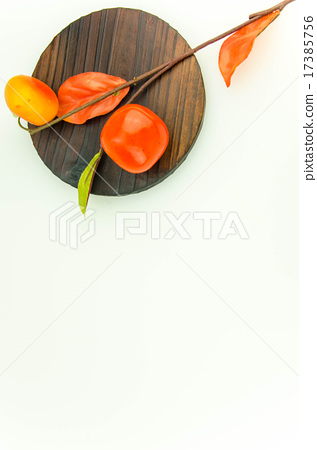 Persimmon and board autumn image 17385756