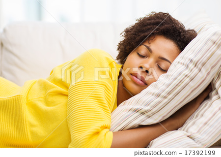 Stock Photo: african young woman sleeping on sofa at home