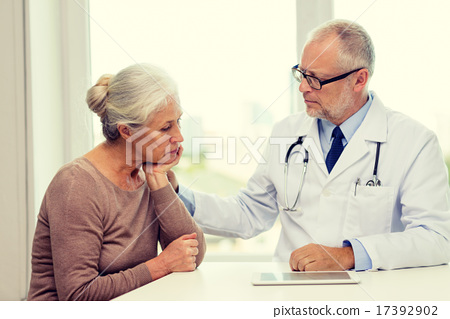 Stock Photo: senior woman and doctor with tablet pc