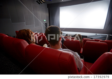 Stock Photo: happy couple watching movie in theater or cinema