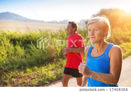 Stock Photo: Senior couple running
