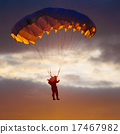 Skydiver On Colorful Parachute In Sunny Sky 17467982