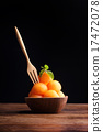 Cantaloupe melon in wooden bowl with wooden fork 17472078