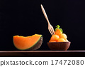 Cantaloupe melon in wooden bowl with wooden fork 17472080