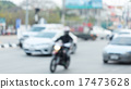 car and motorcycle driving on road with traffic 17473628