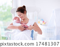 Young mother and newborn baby in white bedroom 17481307
