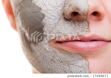 Stock Photo: Skin care. Woman applying clay mask on face. Spa.