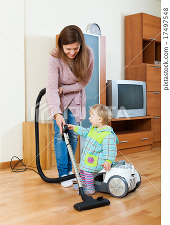 Stock Photo: Mother with baby cleaning home
