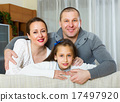 mother, father and cute girl 17497920