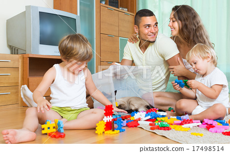 Family of four at home with toys 17498514