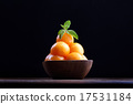 Organic cantaloupe melon in wooden bowl isolated 17531184