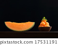 Organic cantaloupe melon in wooden bowl isolated 17531191