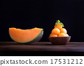 Organic cantaloupe melon in wooden bowl isolated 17531212