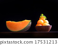 Organic cantaloupe melon in wooden bowl isolated 17531213