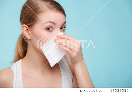 Stock Photo: Flu allergy. Sick girl sneezing in tissue. Health