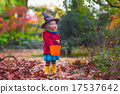 Little girl in witch costume at Halloween 17537642