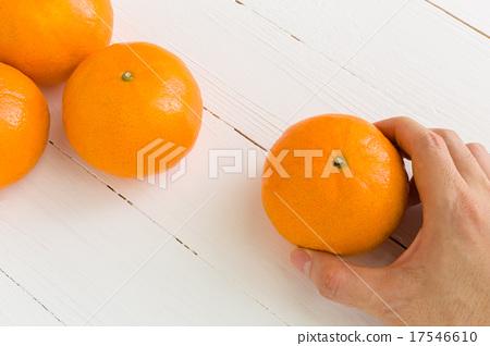 Hand Taking Orange Background 17546610