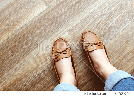 Woman wearing leather flat shoes on wooden floor 17552870